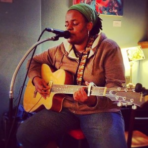 Me singing at my monthly open mic at Bohemian Coffee House! Photo by William Kelly