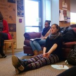 Student's cozy up on the couches in the Women's Center to listen to the stories.